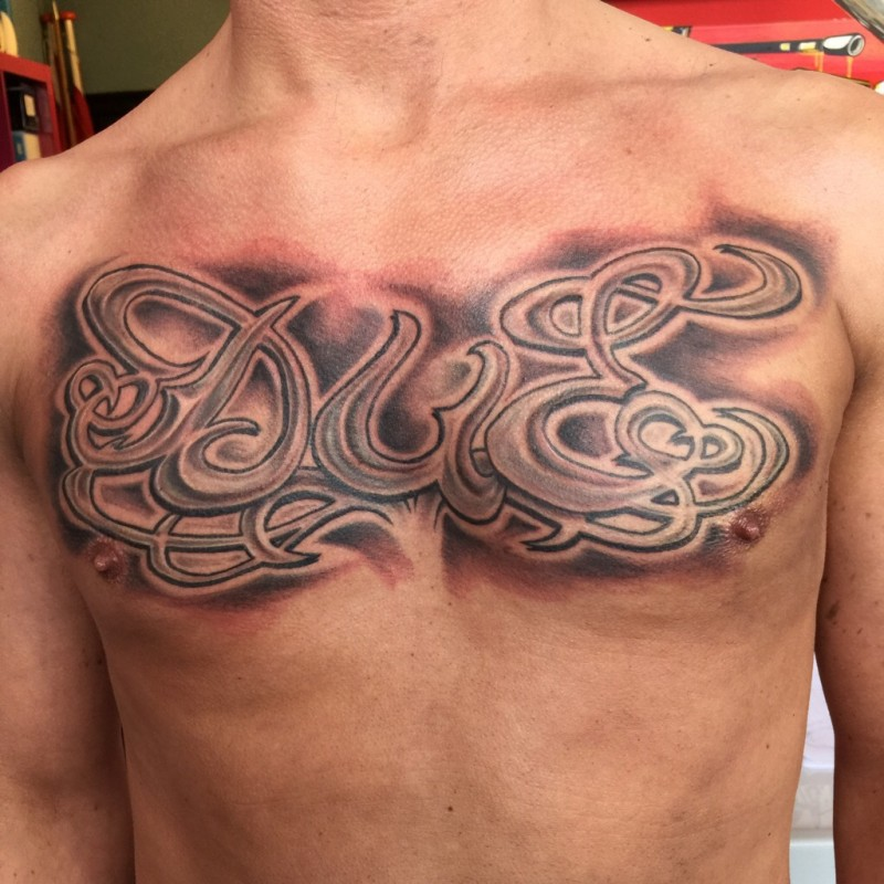 Chicano lettering chest tattoo peter van der helm for Chest tattoo writing