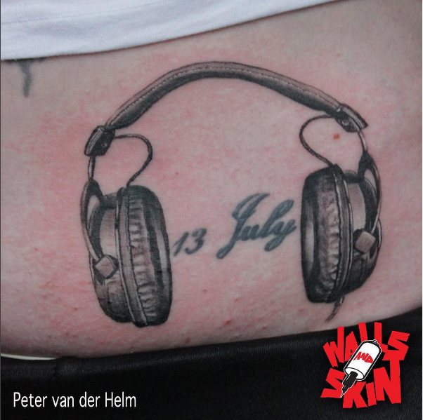 Headphone tattoo black and grey by Peter van der Helm @ Walls and Skin
