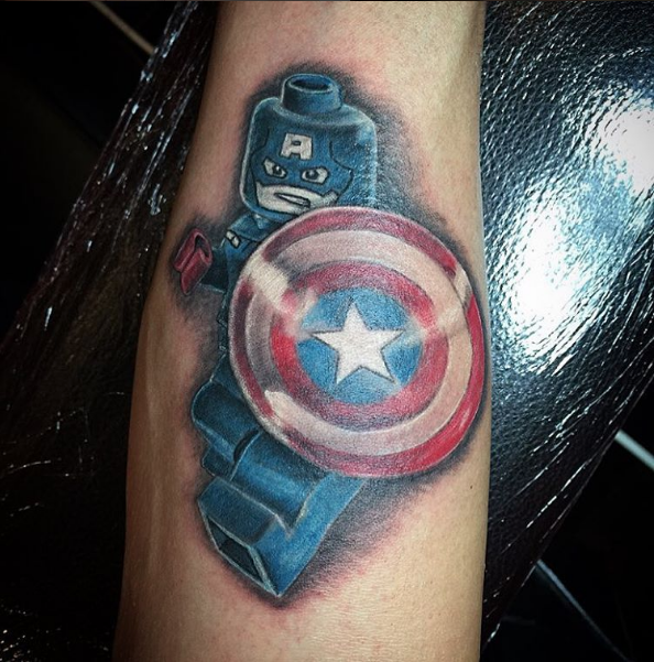 Captain America Lego Tattoo tattoo black and grey by Peter van der Helm @ Walls and Skin