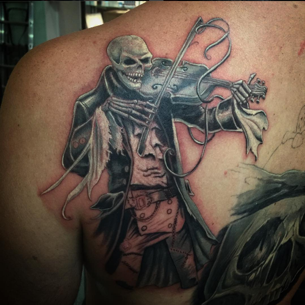 Skulls and Pirates Tattoo tattoo black and grey by Peter van der Helm @ Walls and Skin