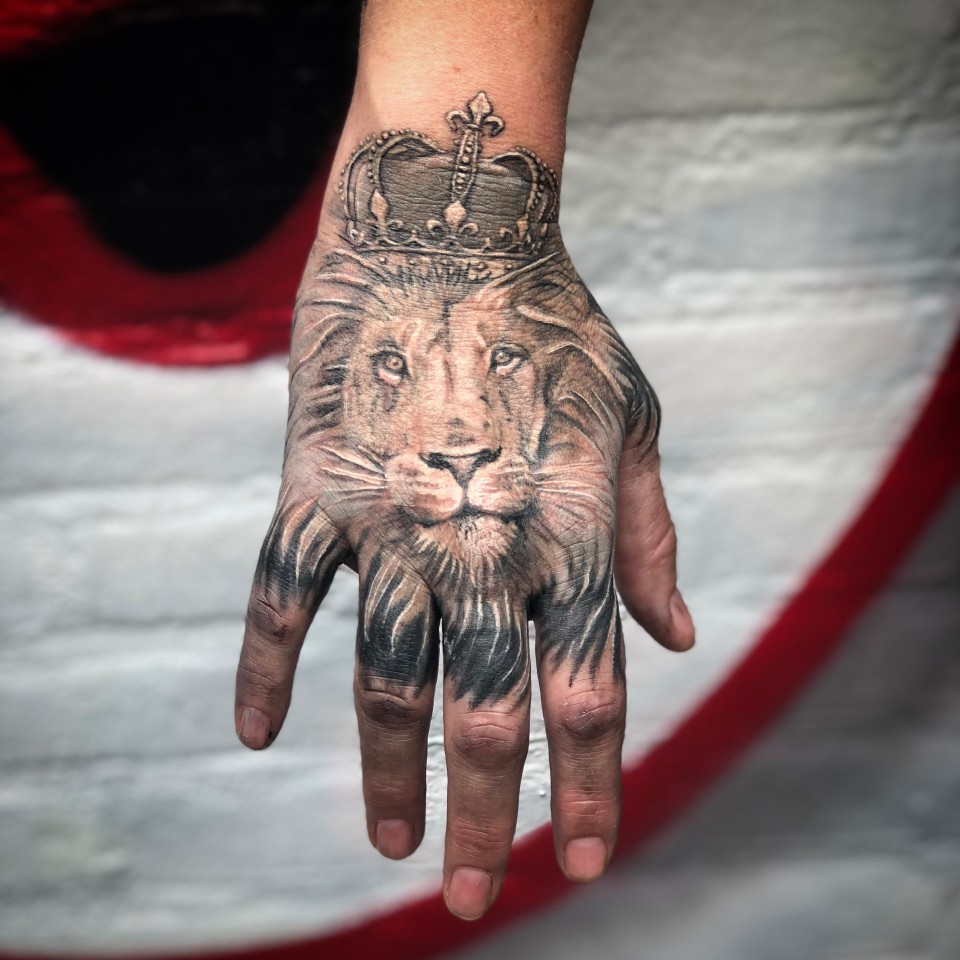 Realistic Lion on Hand Tattoo